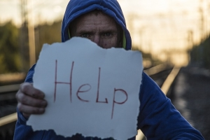 man with help sign