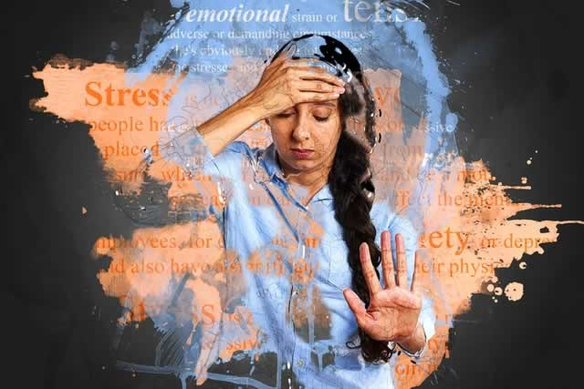 woman with hand on forehead surrounded by words stress anxiety etc