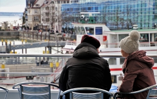 two people on a pier talking